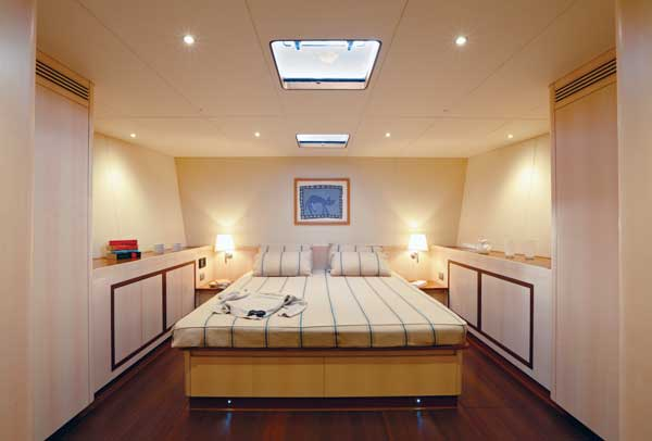 The master suite with its king-size bed is in the forepart of the yacht.